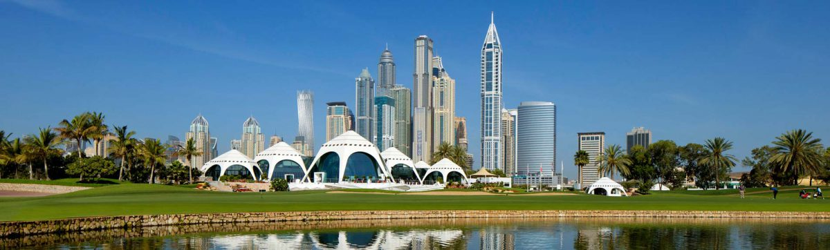 Stunning blue sky day at the Emirates Golf Club in Dubai with eh sky scrapers behind.