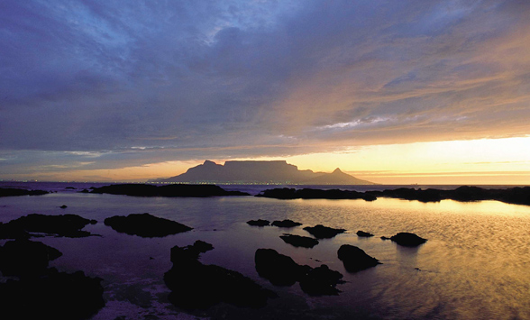 Sun setting over Table Mountain with views across Table Bay.