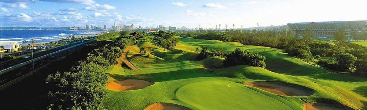 Durban Country Club golf course with skyline of central Durban behind.