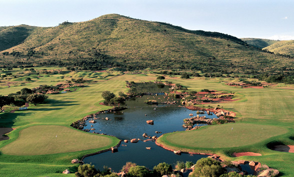 Fairways of the Lost City Golf Course with the Pilanesberg National Park beyond.