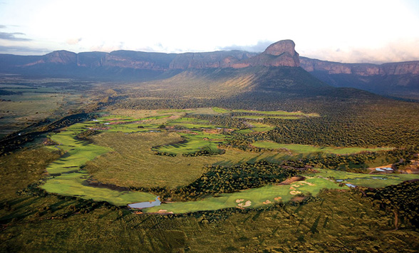 aerial views of the golf course at Entabeni which is surrounded by a game reserve with the touring Hang-up mountain in the distance.