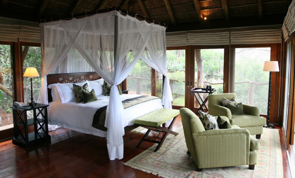 Romantic Four poster bed in the suite at Pumba Game Reserve.