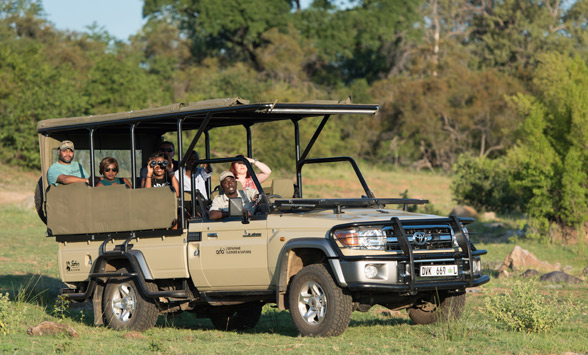 Guests on a game drive vehicle in the Kruger National Park.