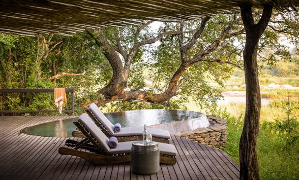 Private deck and Plunge pool at Singita Safari Lodge.
