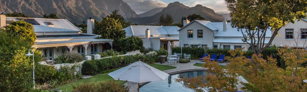 Sun setting in the Franschhoek Mountain Valley over Le Quartier Francais.