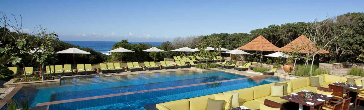 Swimming pool overlooking the Indian ocean and beach at the Fairmont Zimbali Resort.