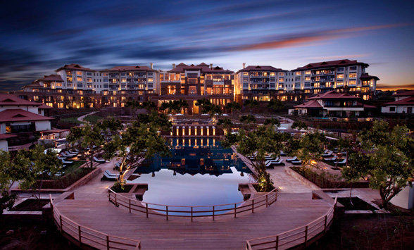 Sunset over the Fairmont Zimbali Hotel reflected in the pool.