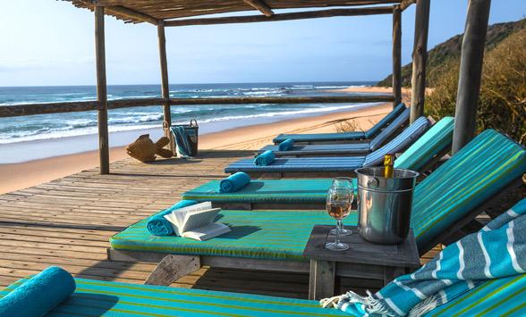 Sun loungers on the beach at Thonga Beach Lodge.