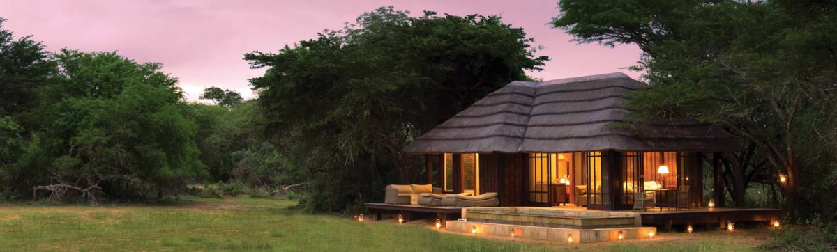 Sunset over the rooms at Vlei Lodge on the Phinda Reserve.