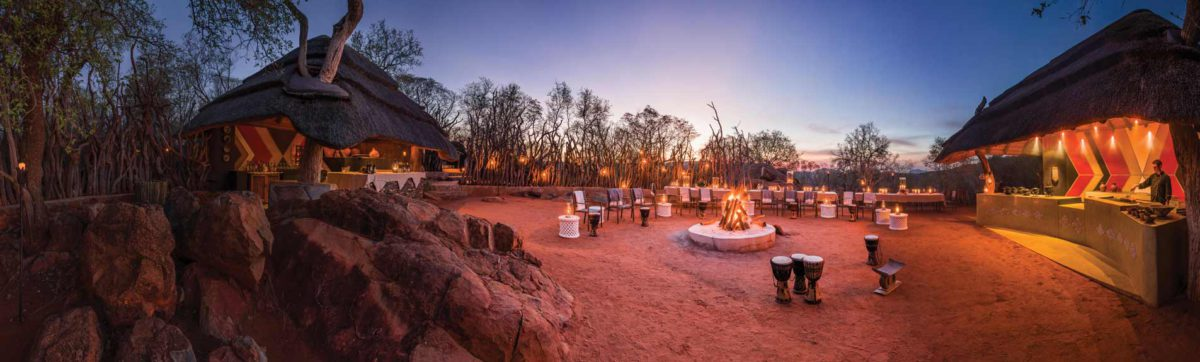 Dining under the stars by a roaring fire in the Madikwe Hills Game Lodge Boma.