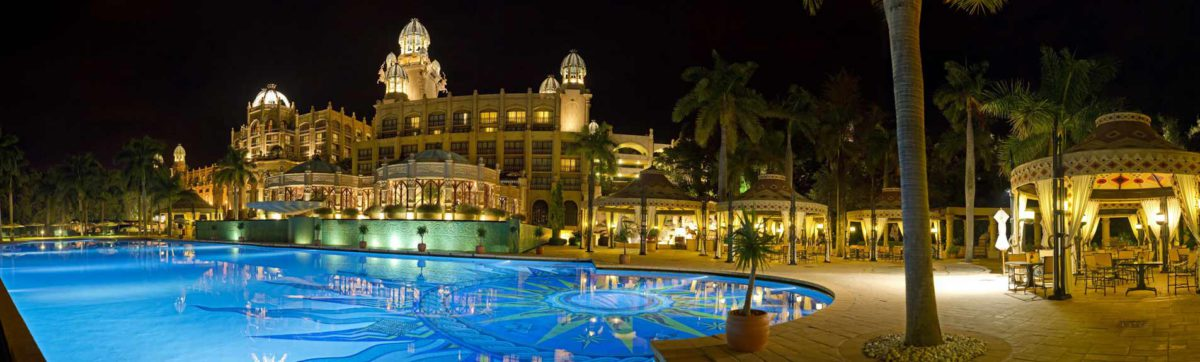 Palace of the Lost City Hotel swimming pool lit up at night.