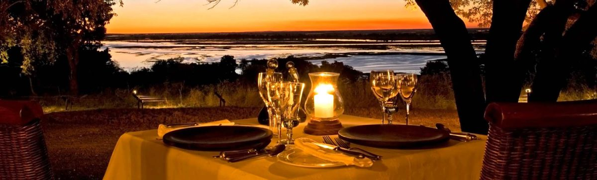 Romantic dining and sunset over the Chobe River.