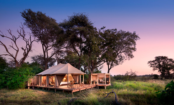 sun set in the Okavango above the tented suite at Nxabega.