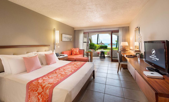 Bedroom and restaurants around the Constance Belle Mare Plage Hotel