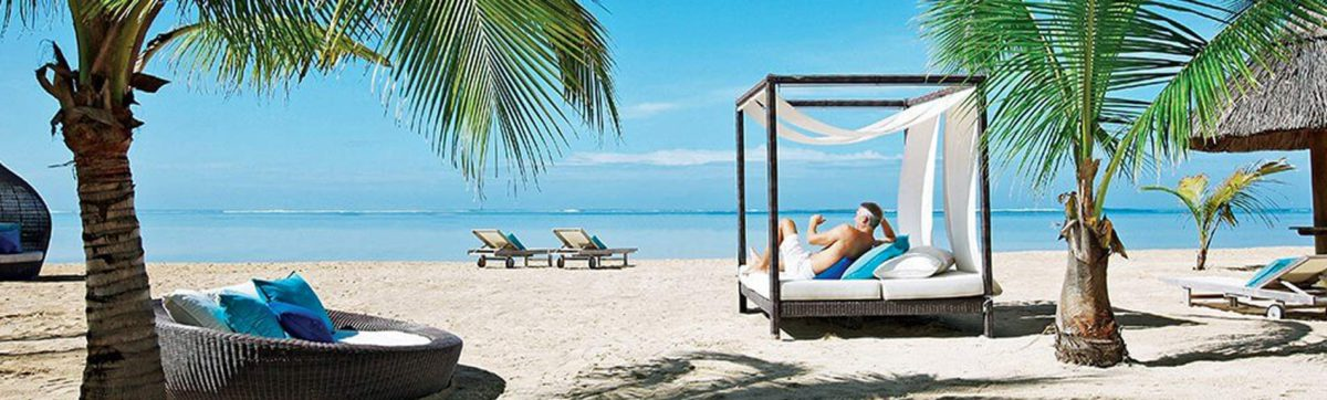 Soaking up the sun on a lounger on the Bel Ombre beach at the Heritage Awali Hotel.