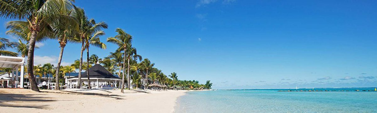 powder white sand beach and azure blue Indian ocean at the the Heritage Le Telfair Hotel.