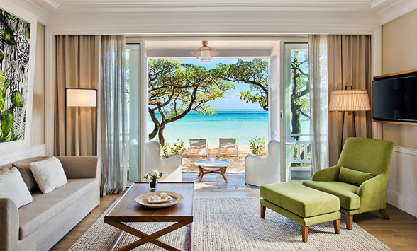 Turquoise blue lagoon through the window of a beach villa at Heritage Le Telfair