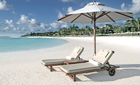 sun loungers on the idyllic palm fringed beaches of Mauritius.
