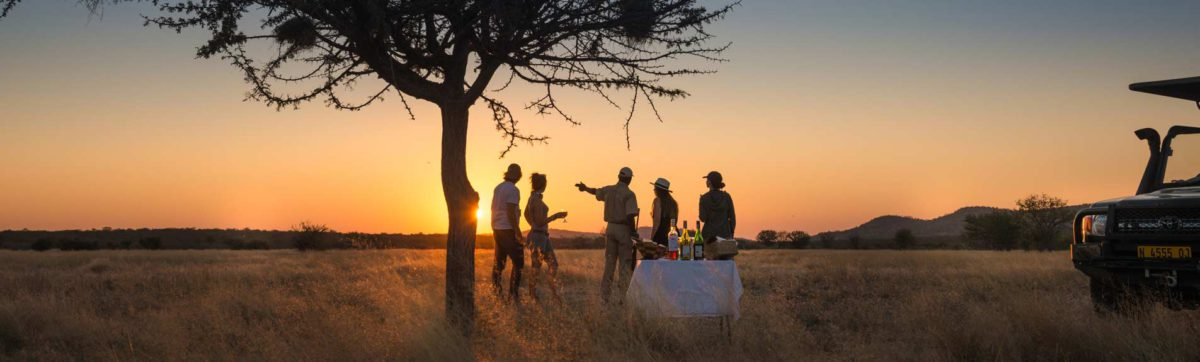 Sun downer drinks stop as the sun sets over the Etosha National Park area.