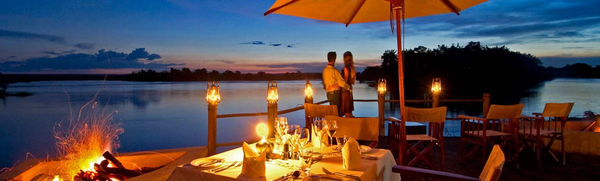 Romantic candle lit dinner on the deck of Sussi and Chuma Lodge overlooking the Zambezi River.