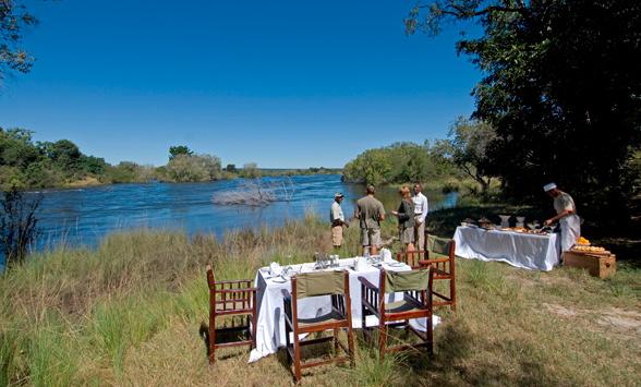Picnic set up on Livingstone Island overlooking the Zambezi River at Victoria Falls.