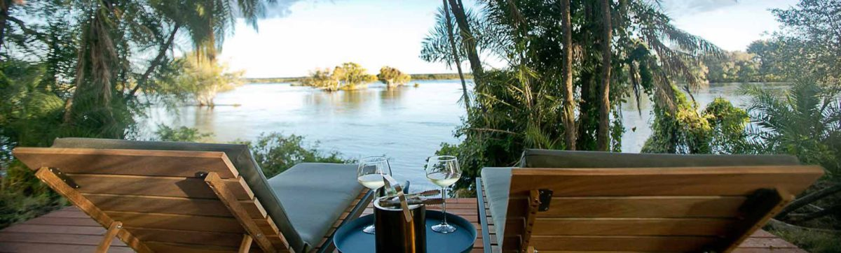 relaxing in sun loungers overlooking the banks of the zambezi river.