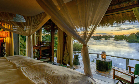 romantic setting at Tongabezi with views from the private deck of Victoria Falls.