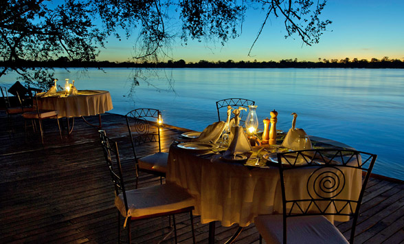 Romantic table setting overlooking the Zambezi River in Zambia.
