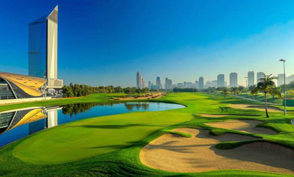 blue skies over the green fairways and lakes of the Faldo Course, Dubai.