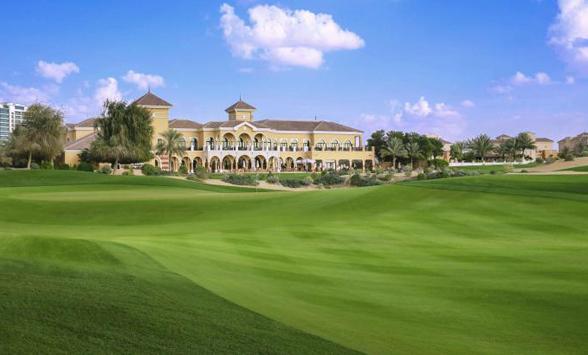 Lusy, verdant fairway of the 18th hole at The Els Club, Dubai.