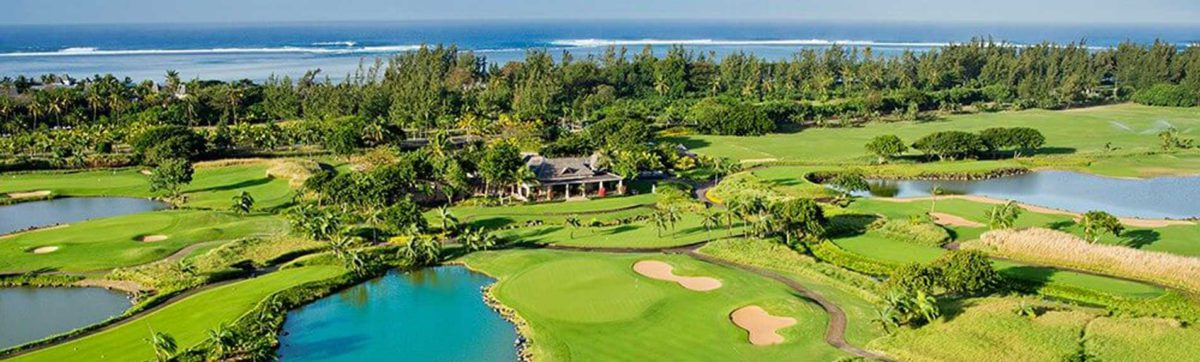 aerial view of the golf course in Mauritius with the blue ocean beyond.