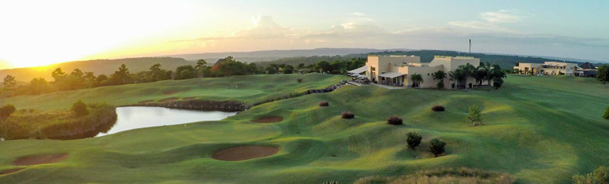 Sun rising over the Indian Ocean and long shadows on the golf course at Vipingo Ridge.