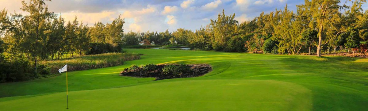 flag pin, green and fairways at Anahita Golf Club