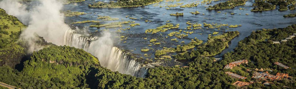 Aerial view of the spray at Victoria Falls and the Zambezi River.