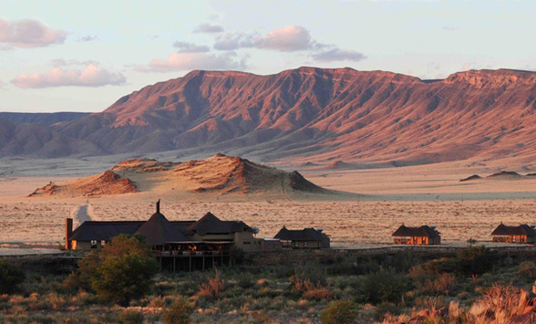 Lodge building nestled in the valley overlooking the Namib desert and mountains.