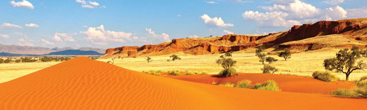 Red sand dunes and rock formations